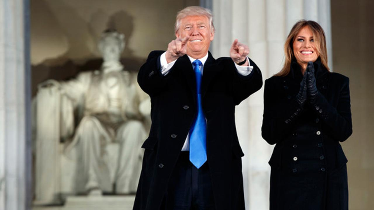 President-elect Donald Trump, left, and his wife Melania Trump arrive to the Make America Great Again Welcome Concert at the Lincoln Memorial, Thursday, Jan. 19, 2017.