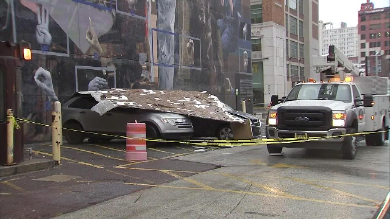A mural fell on parked cars amid high wind at Hahnemann University Hospital in Philadelphia on January 23.