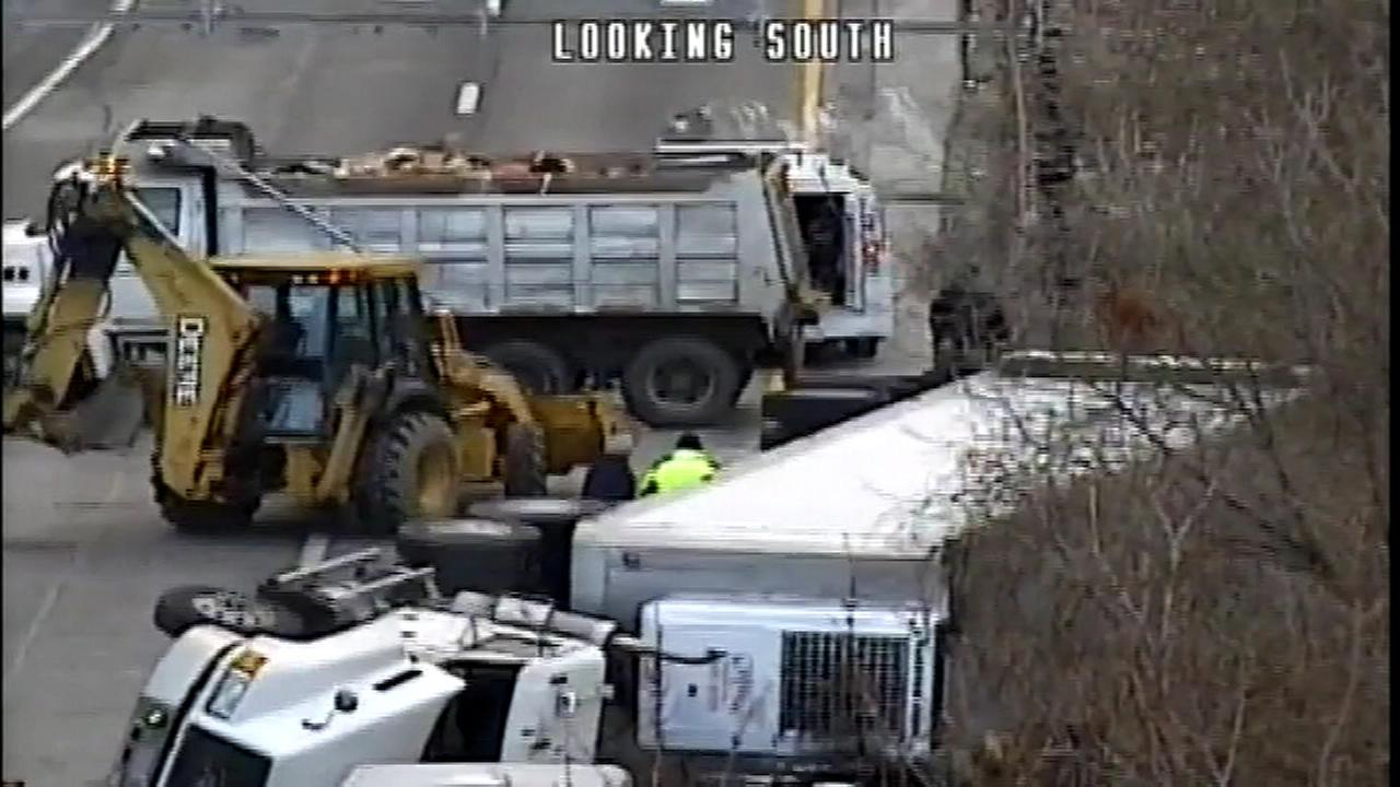 February 1, 2017: Crews work to clear a crash involving an overturned tractor trailer that shut down a ramp from I-95 to the Blue Route (I-476) in Delaware County.