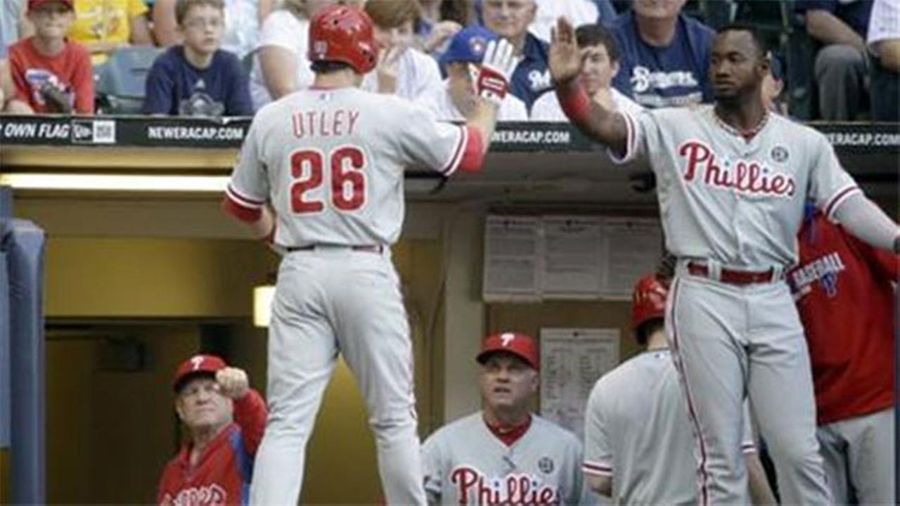 Philadelphia Phillies Chase Utley is congratulated after hitting a home run during the first inning of a baseball game against the Milwaukee Brewers Wednesday, July 9, 2014, in Mi