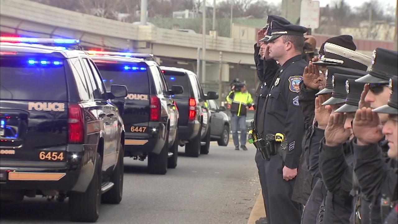 The body of Sgt. Steven Floyd is escorted to the medical examiners office in Wilmington, Delaware.