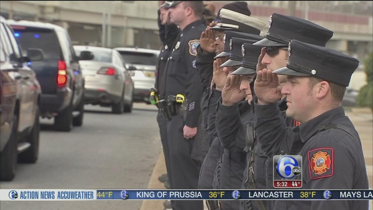Procession, salute for fallen Del. corrections officer