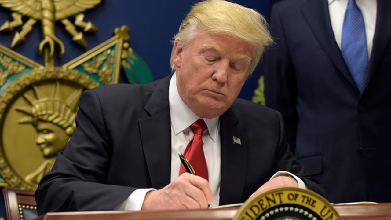 President Donald Trump signs an executive order on extreme vetting during an event at the Pentagon in Washington, Friday, Jan. 27, 2017.