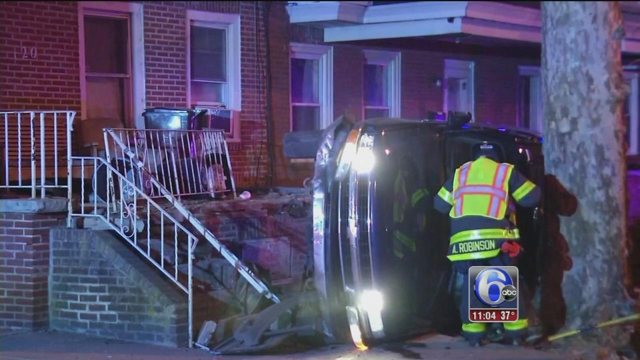 Suspect crashes SUV into front porch in Wilmington