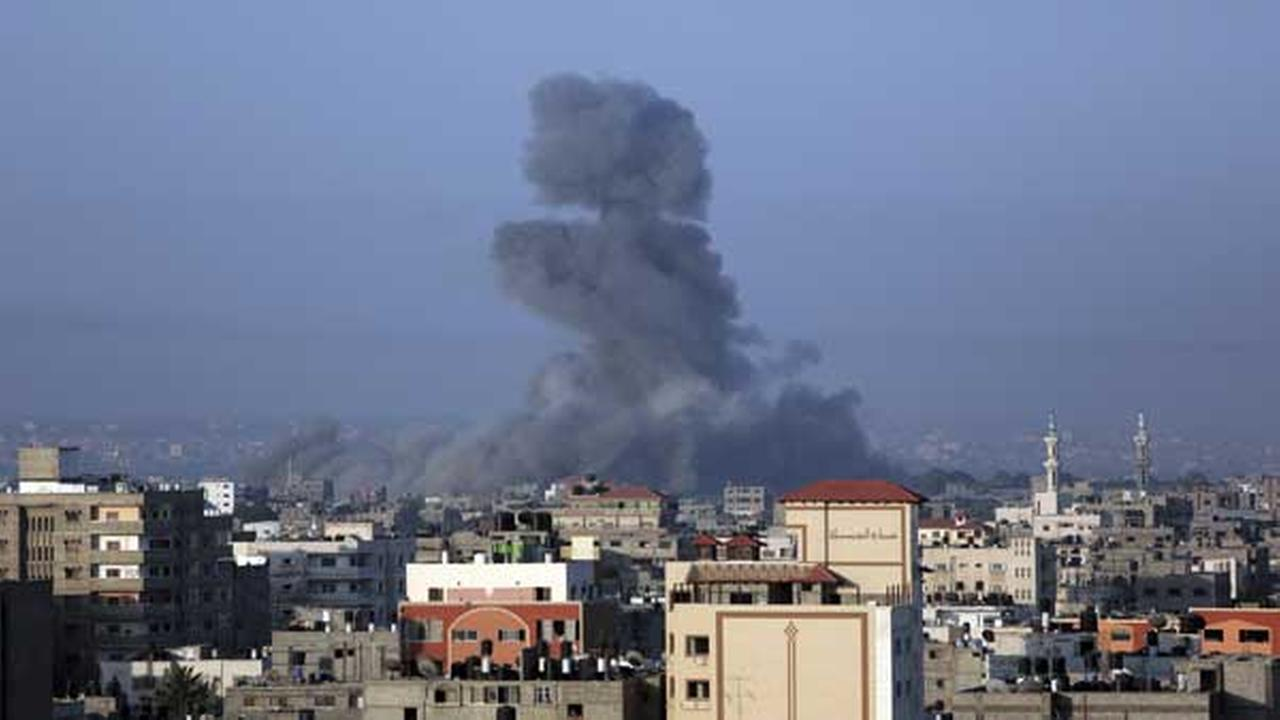 Smoke rises after a strike in Gaza City on Thursday, July 10, 2014.