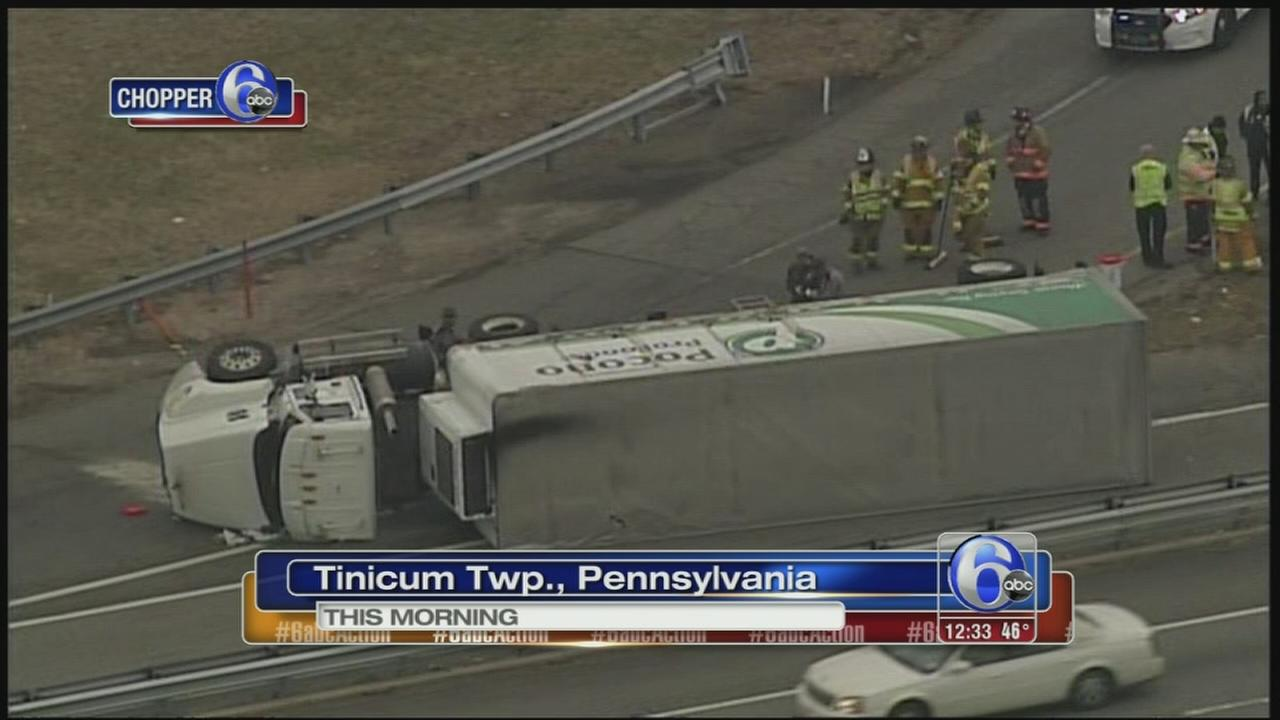 Tractor trailer overturns on ramp to I-95