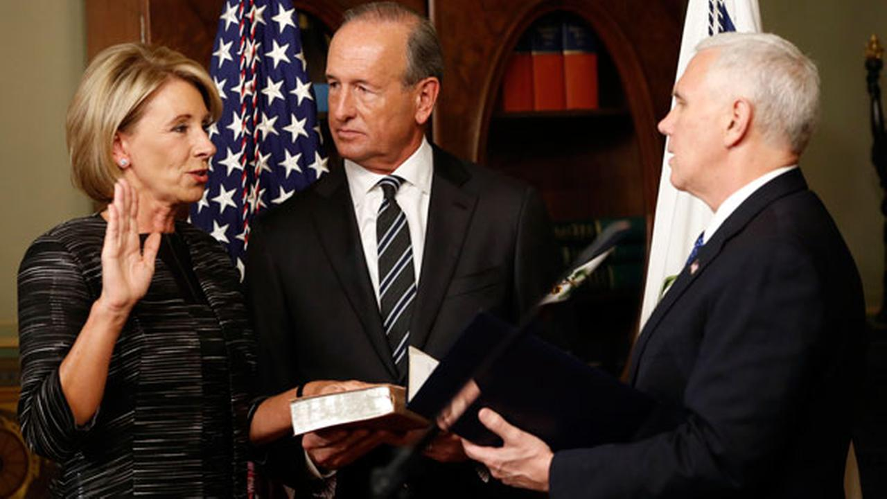 Vice President Mike Pence swears in Education Secretary Betsy DeVos in the Eisenhower Executive Office Building in the White House complex in Washington, Tuesday, Feb. 7, 2016.