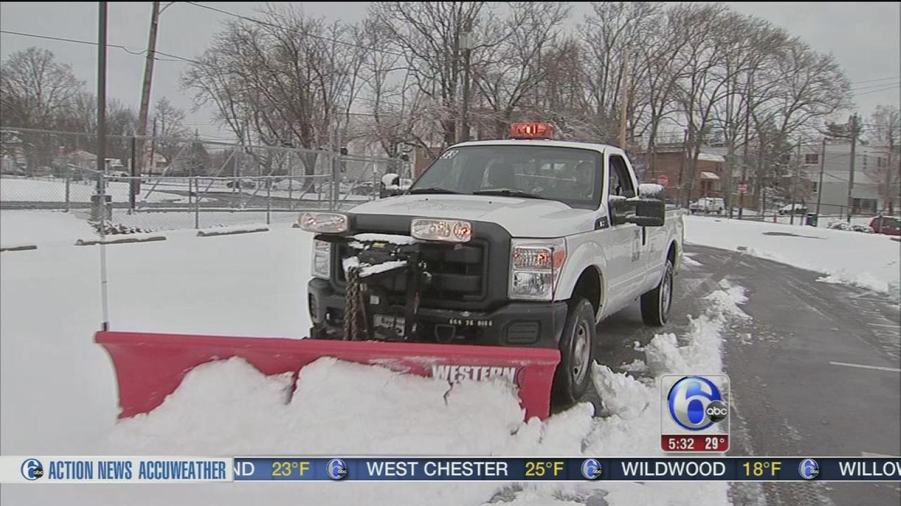 Plow drivers hit the road as snow falls