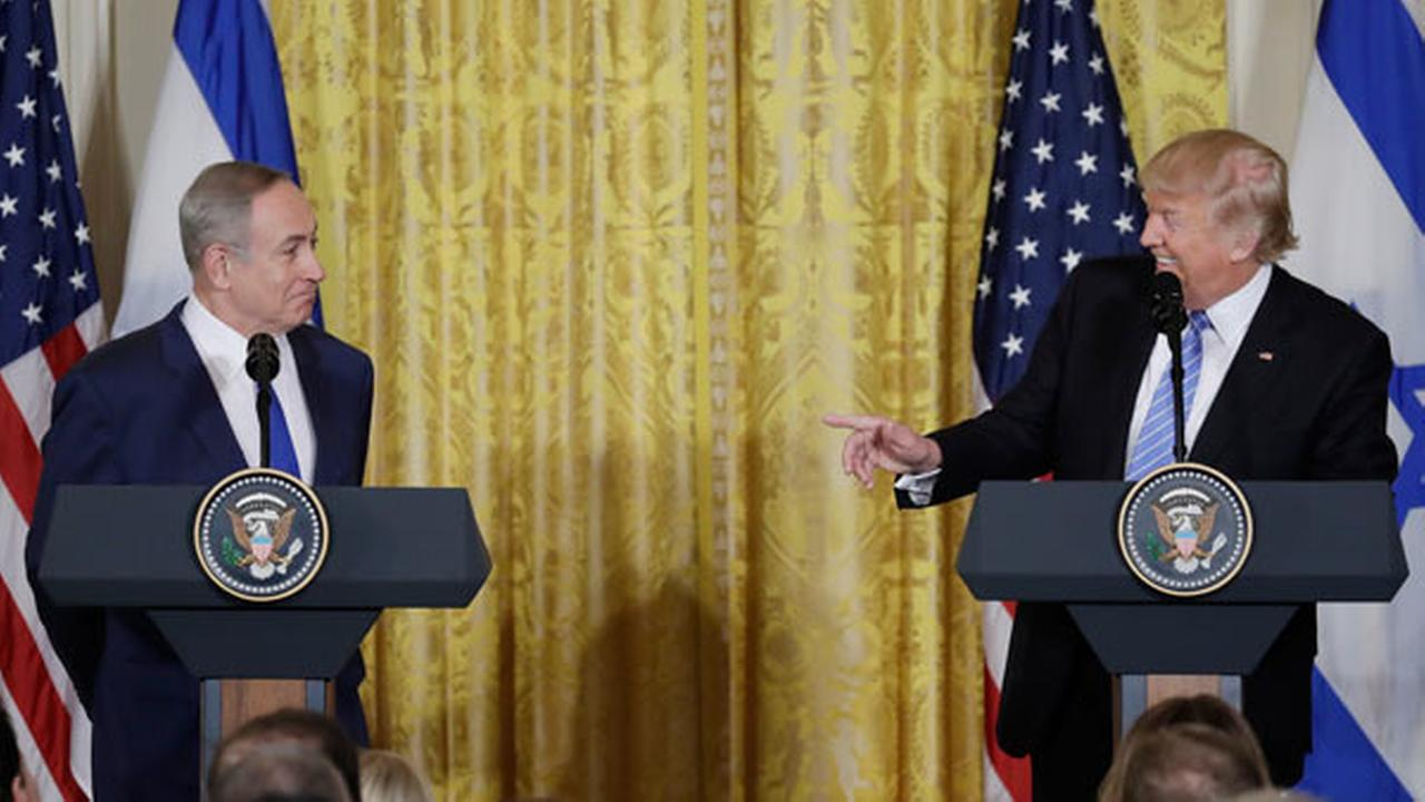 President Donald Trump and Israeli Prime Minister Benjamin Netanyahu participate in a joint news conference in the East Room of the White House in Washington.