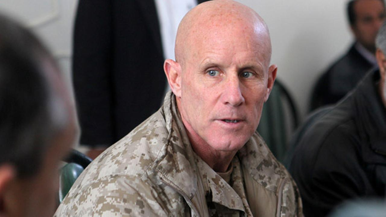 In this image provided by the U.S. Marine Corps, Vice Adm. Robert S. Harward, commanding officer of Combined Joint Interagency Task Force 435, speaks to an Afghan official