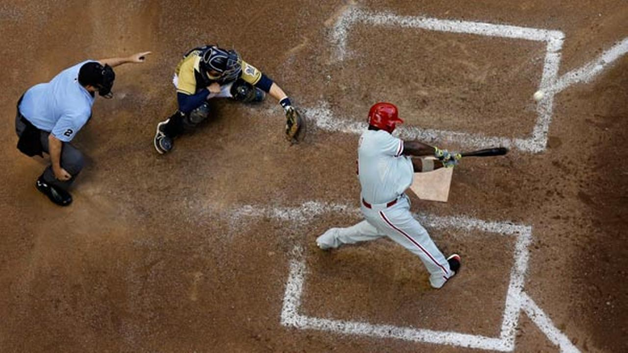 Philadelphia Phillies Ryan Howard hits a two-run scoring double during the eighth inning of a baseball game against the Milwaukee Brewers Thursday, July 10, 2014, in Milwaukee.