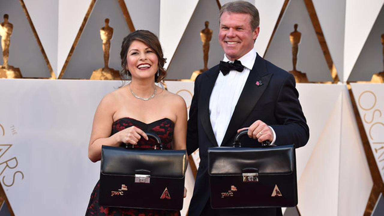Martha Ruiz, left, and Brian Cullinan of PricewaterhouseCoopers, carry the envelops of the winners at the Oscars on Sunday, Feb. 28, 2016, at the Dolby Theatre in Los Angeles.