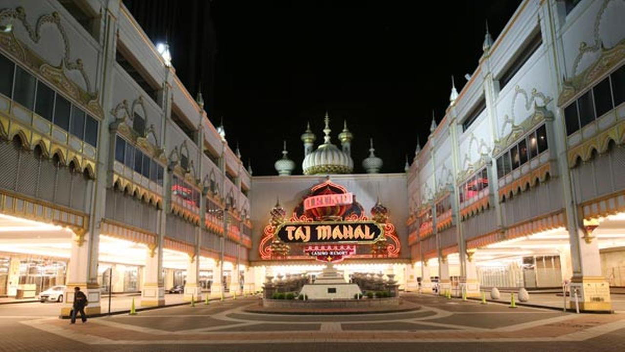 A person walks from the Trump Taj Mahal, early Monday, Oct. 10, 2016, in Atlantic City, N.J.