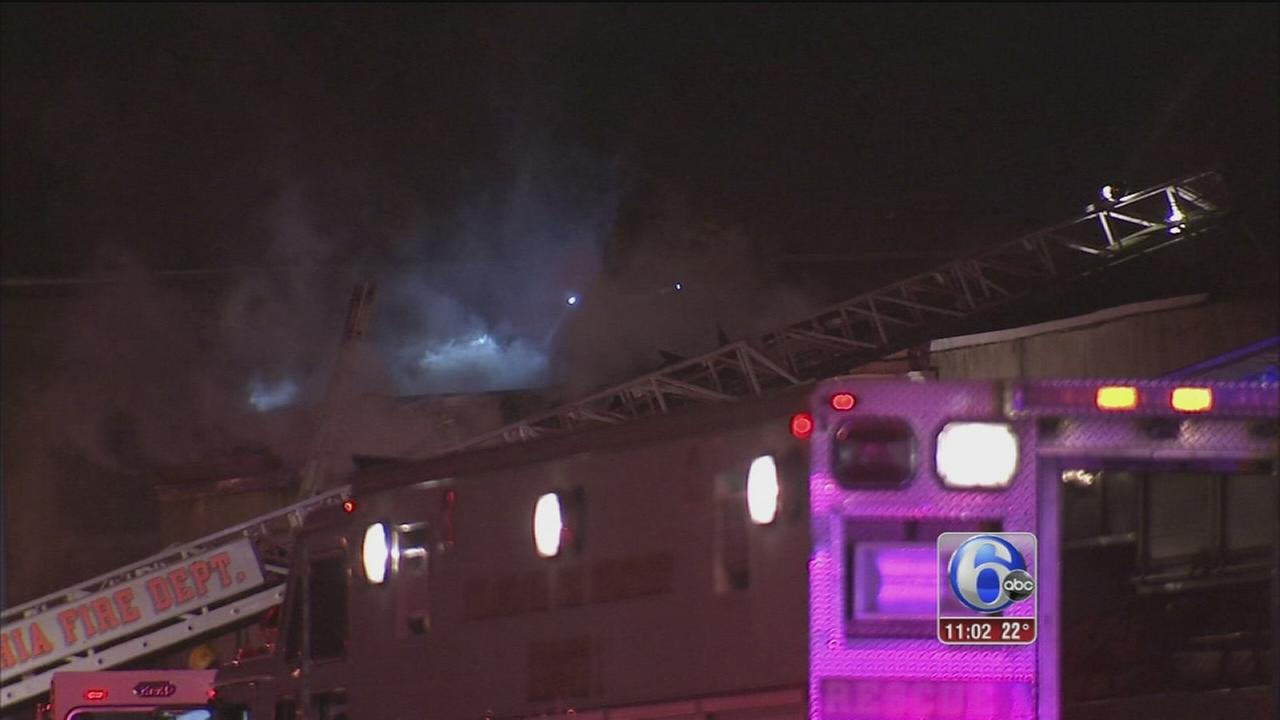 Firefighters battle warehouse fire in Kensington