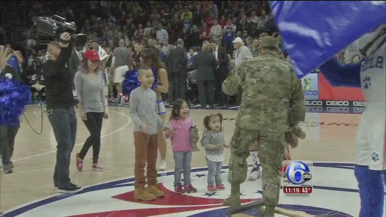 Returning soldier surprises family at 76ers game