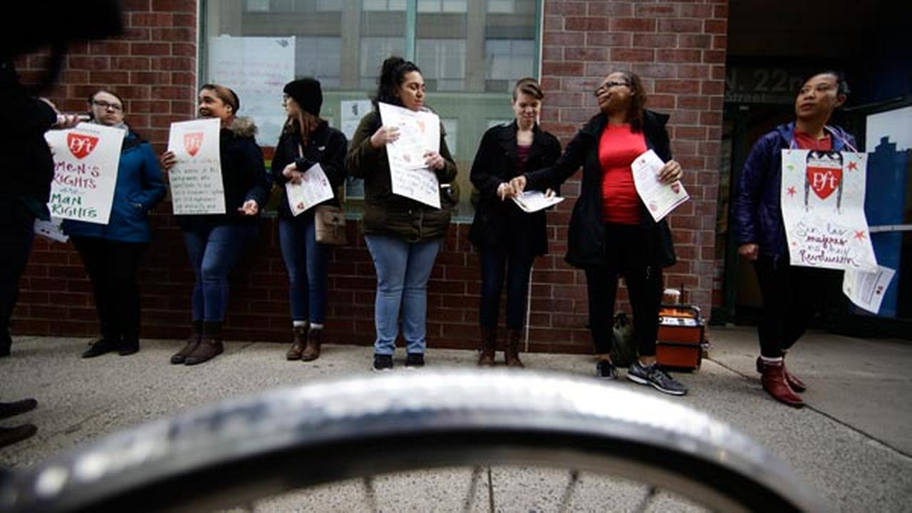 Teachers take part in a A Day Without A Woman demonstration outside the Science Leadership Academy in Philadelphia, Wednesday, March 8, 2017.