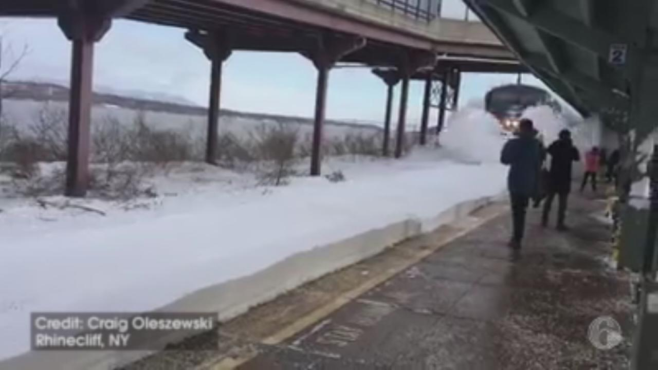 VIDEO: Amtrak train sends wave of snow onto passengers