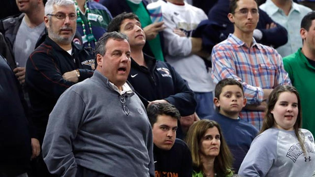 FILE: Gov. Chris Christie, left, watches during the first half of a regional final mens college basketball game between Notre Dame and North Carolina March 27, 2016.
