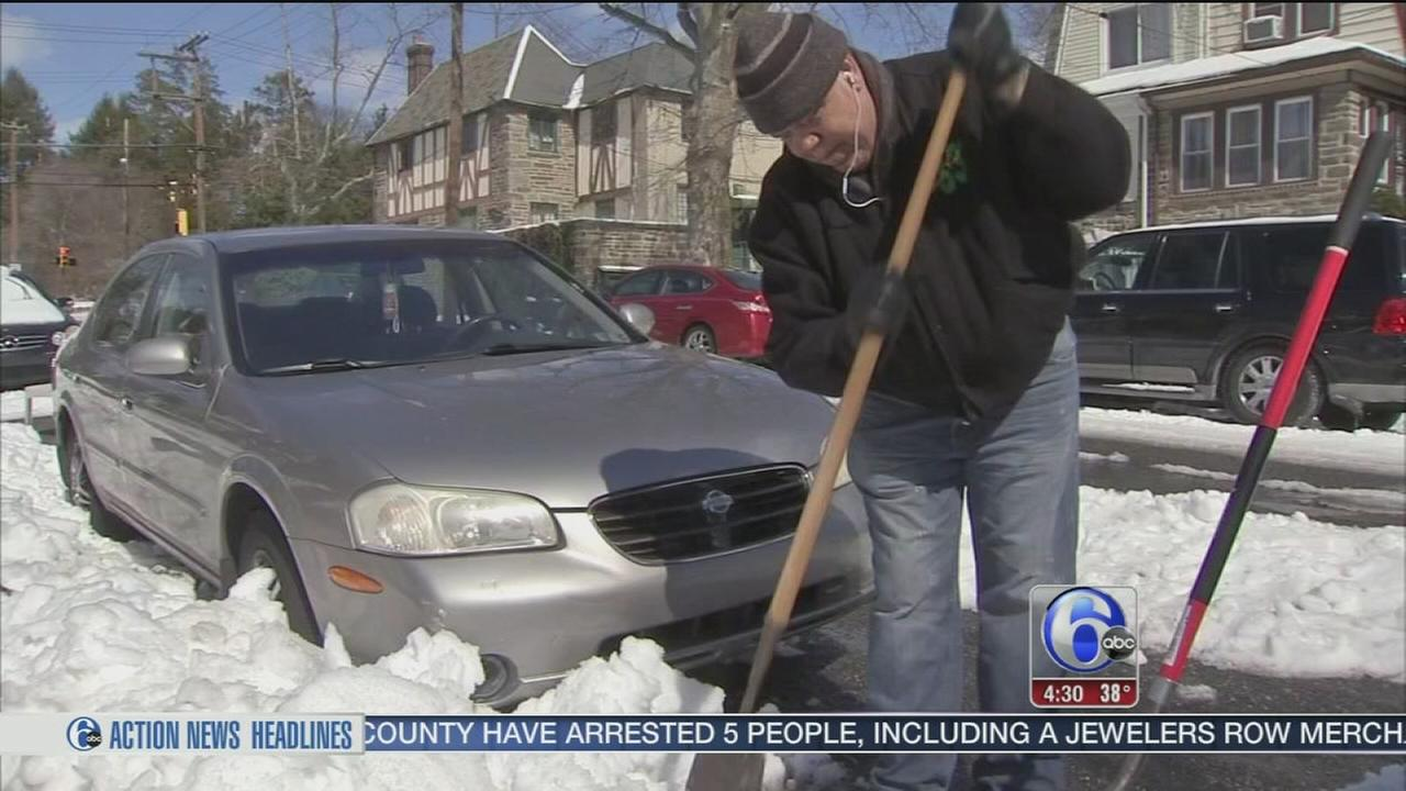 Work continues to clear snowy streets after noreaster