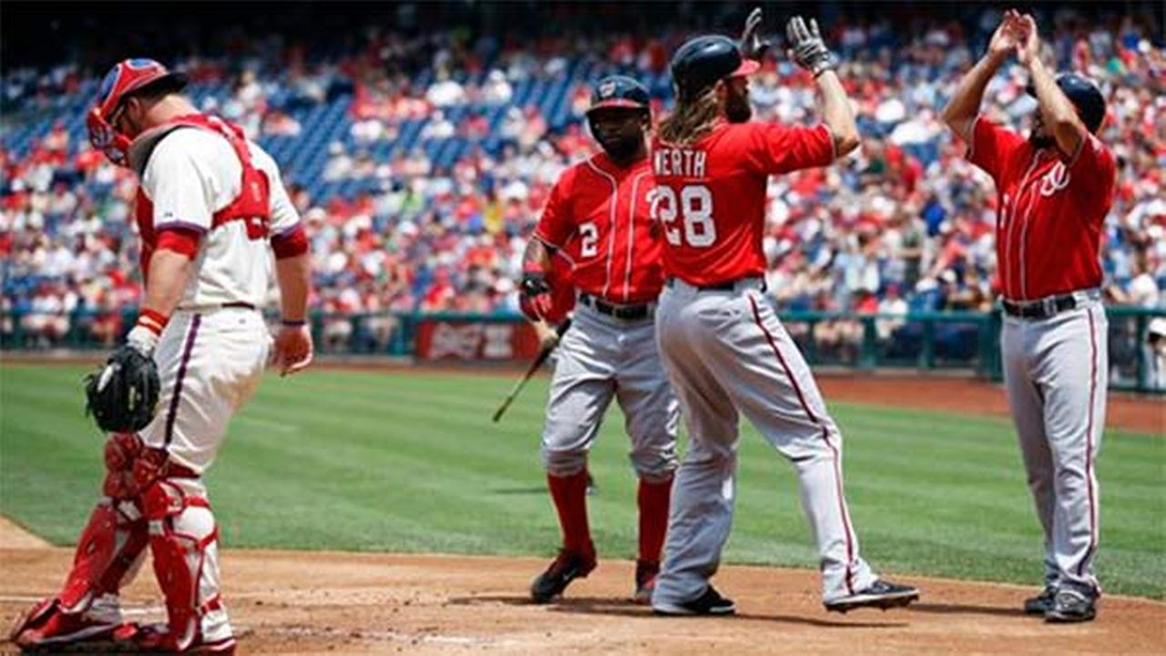 Washington Nationals Anthony Rendon, Jayson Werth and Denard Span celebrate behind Philadelphia Phillies catcher Cameron Rupp on Sunday, July 13, 2014, in Philadelphia.