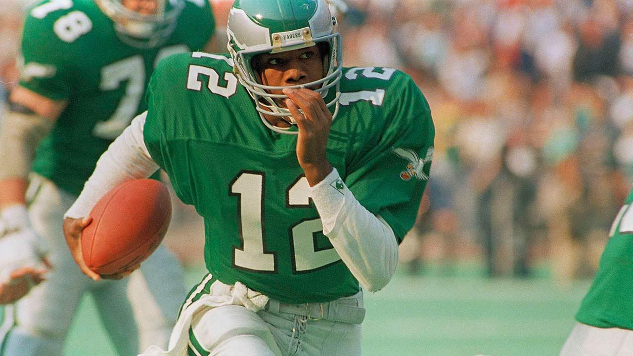 Philadelphia Eagles quarterback Randall Cunningham runs with the ball against the Washington Redskins during first quarter action in Philadelphia, Nov. 9, 1987.