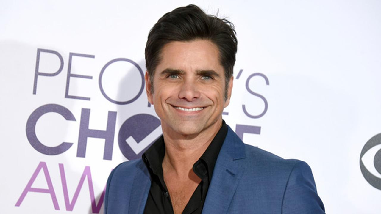 John Stamos arrives at the Peoples Choice Awards at the Microsoft Theater on Wednesday, Jan. 18, 2017, in Los Angeles.