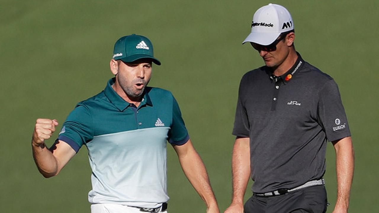 Sergio Garcia, of Spain, reacts in front of Justin Rose, of England, after making an eagle putt on the 15th hole.