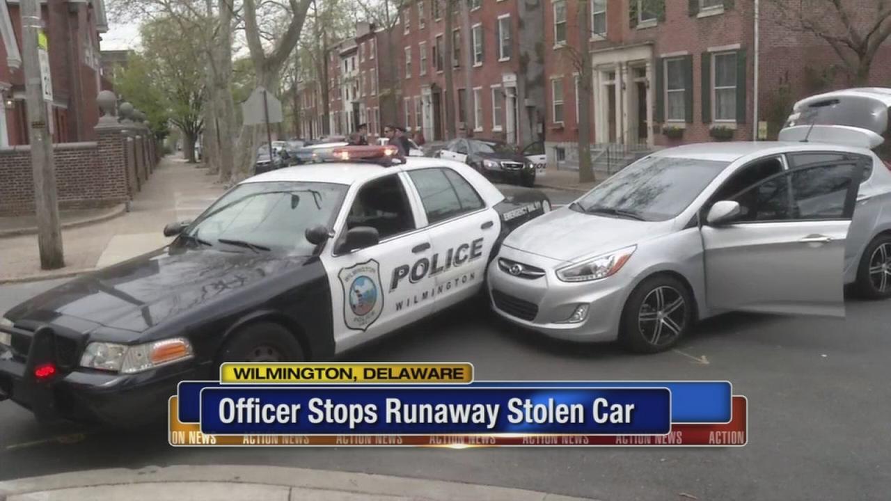 Officer stops runaway stolen car