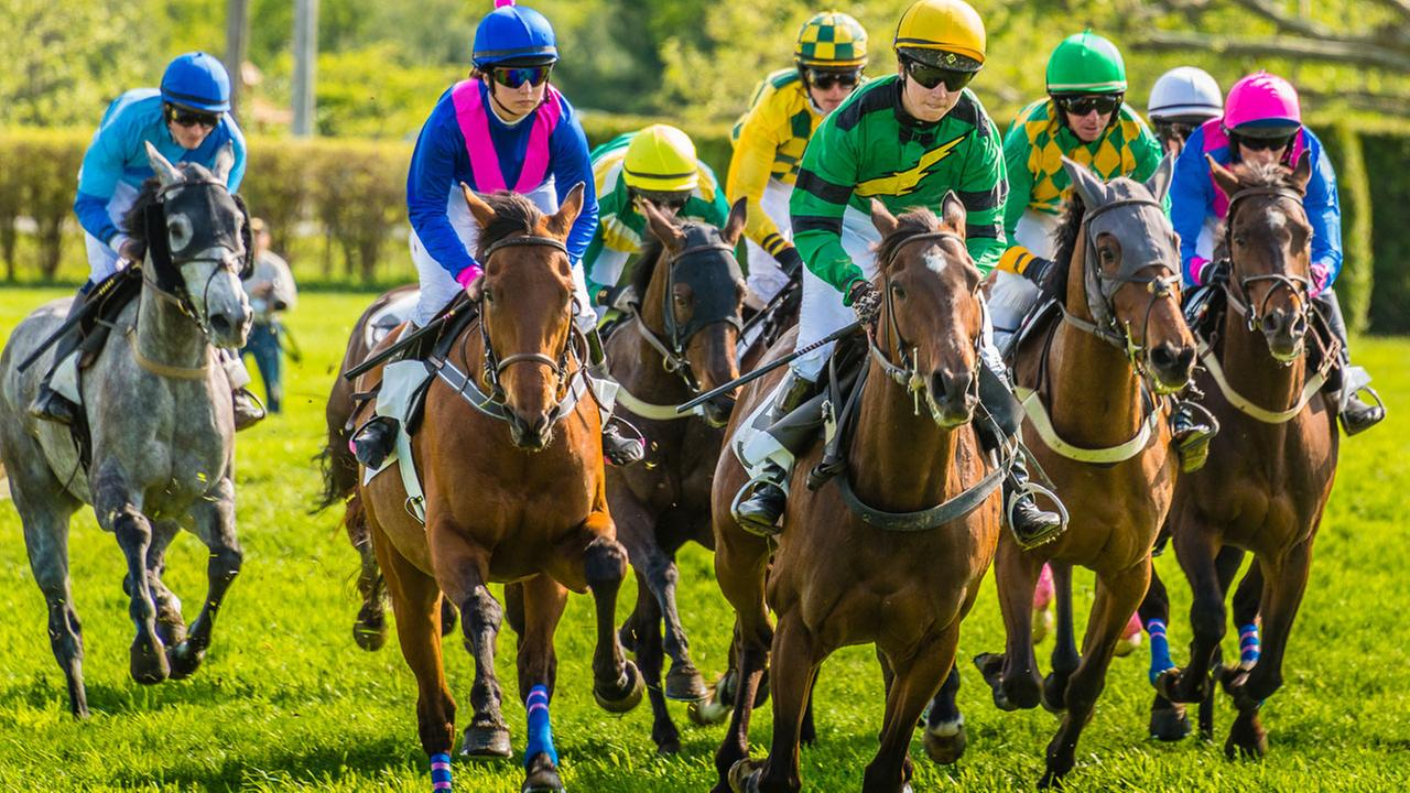 Jockeys make their move during a past race.