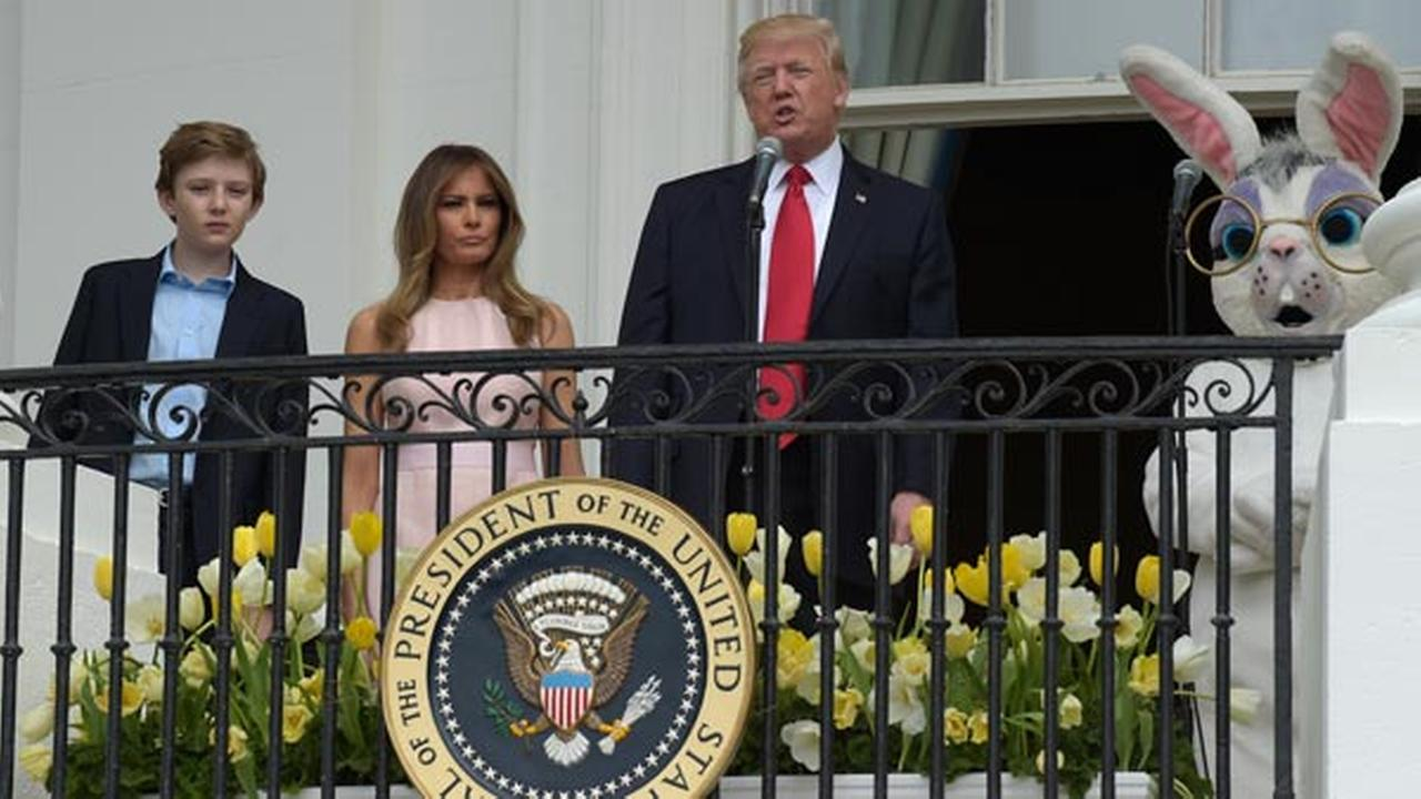 President Donald Trump, standing with his son Barron Trump, first lady Melania Trump, and Easter Bunny, address the crowd at the annual White House Easter Egg Roll.