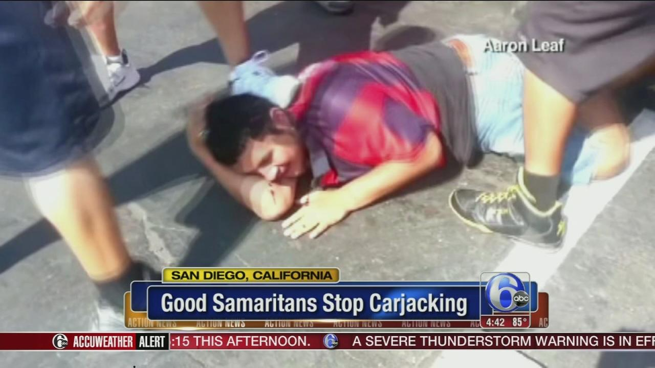 VIDEO: Bystanders attack carjacker
