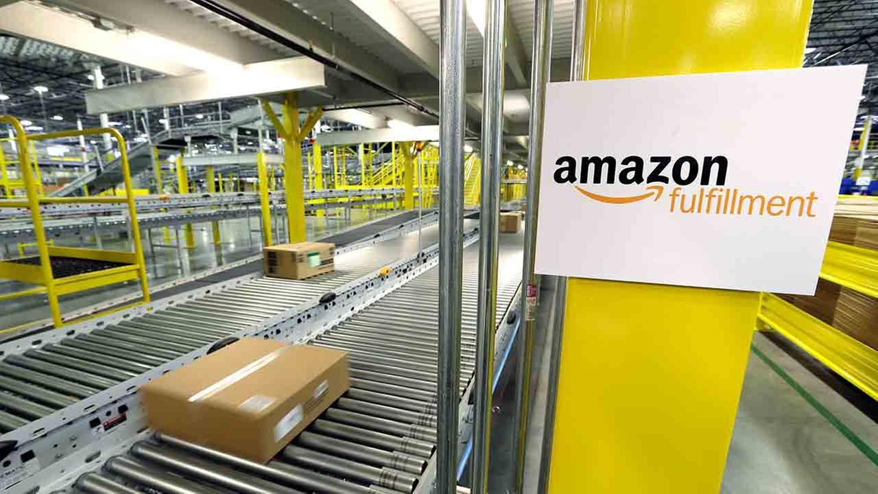 A package moves along a conveyor belt, Friday, Feb. 13, 2015, during a media tour of an Amazon.com fulfillment center in DuPont, Wash.