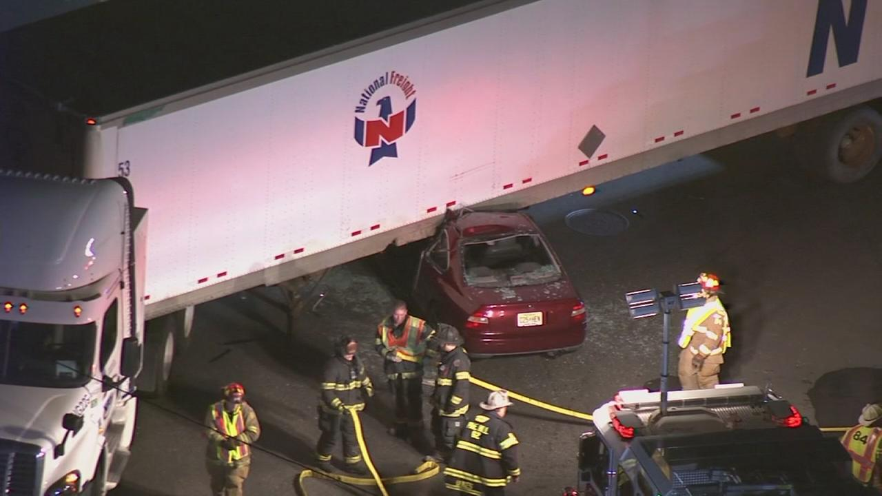 Car wedged under truck after crash in NJ
