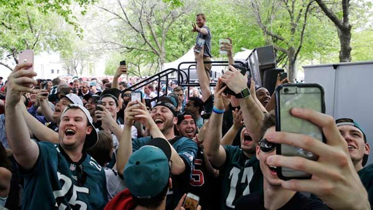 Fans make selfies with Philadelphia Eagles Carson Wentz, top rear, ahead of the 2017 NFL football draft in Philadelphia, Thursday, April 27, 2017.