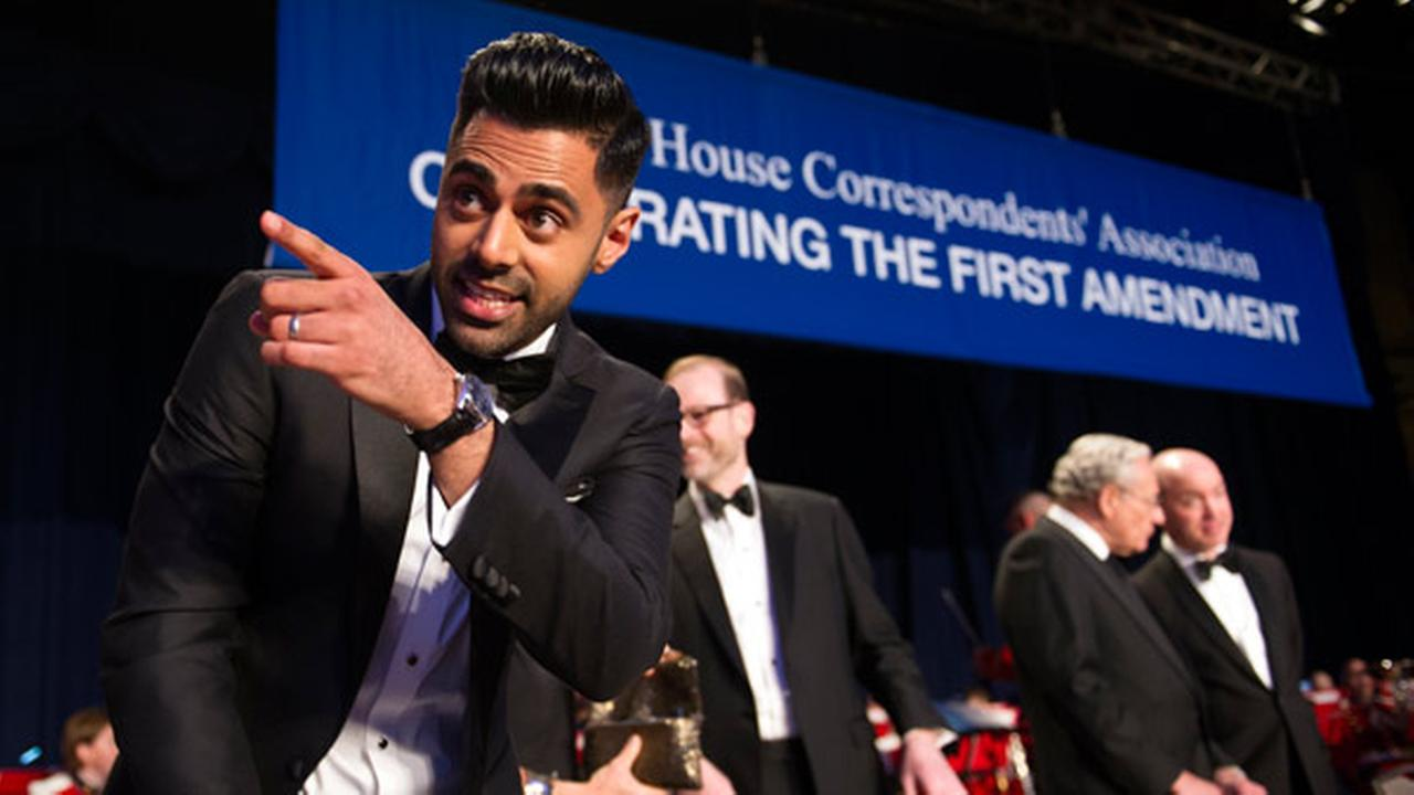 The Daily Show correspondent Hasan Minhaj stands at the head table during the White House Correspondents Dinner in Washington, Saturday, April 29, 2017.