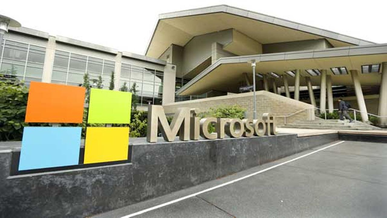 This July 3, 2014 photo shows Microsoft Corp. signage outside the Microsoft Visitor Center in Redmond, Wash.