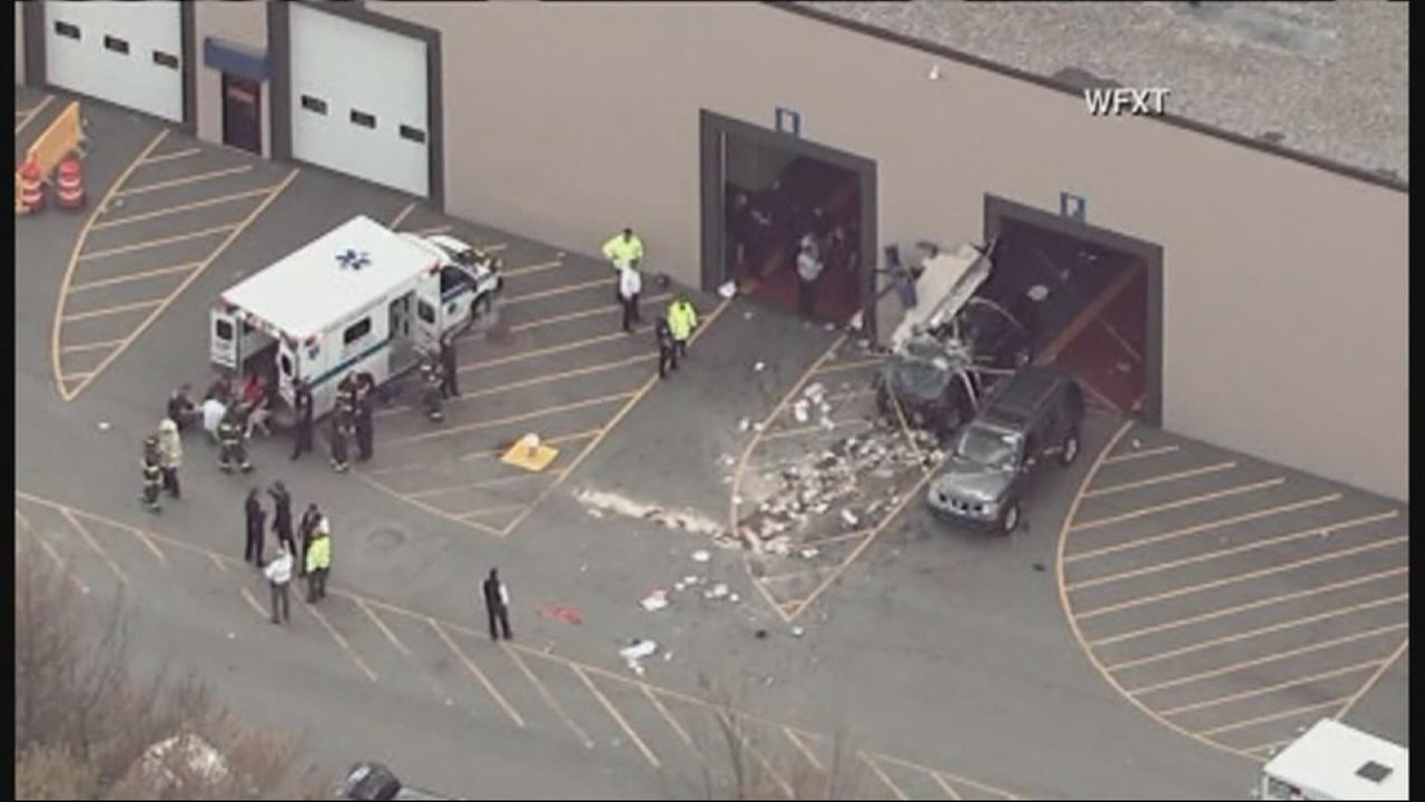 Vehicle crashes during auto auction in Massachusetts, striking several people