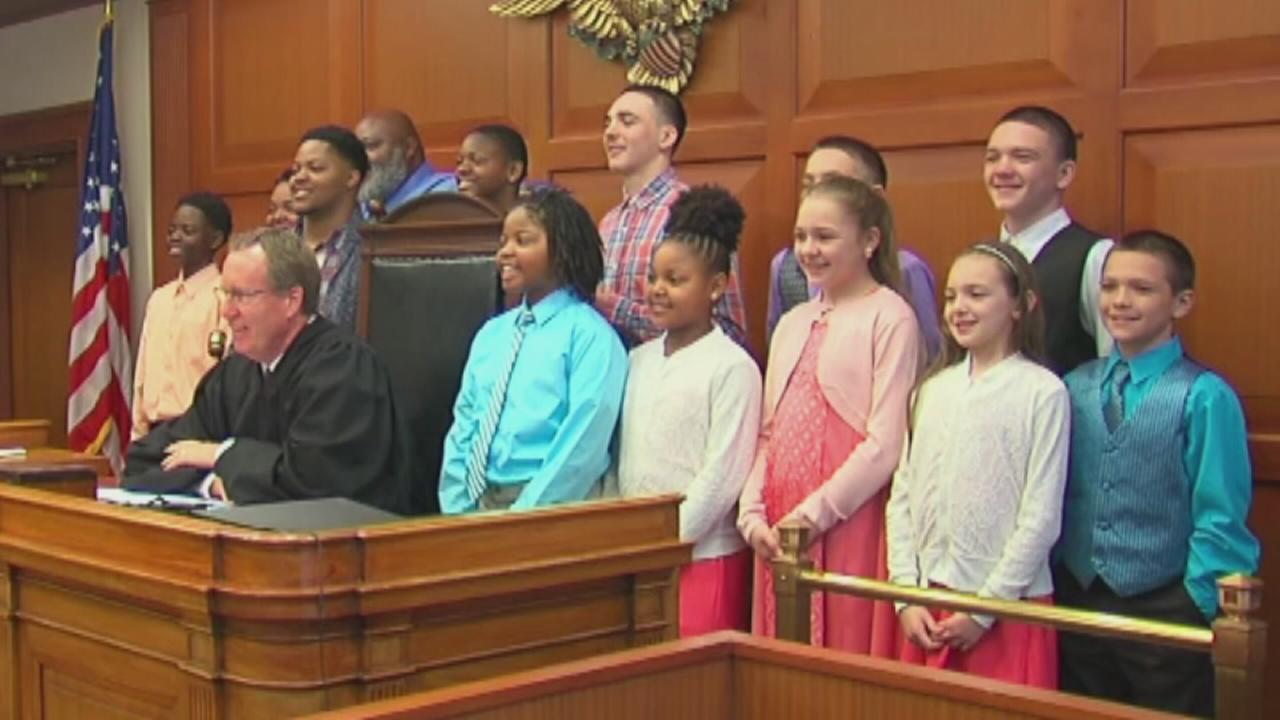 Image for Family with 5 children adopts 6 foster children siblings