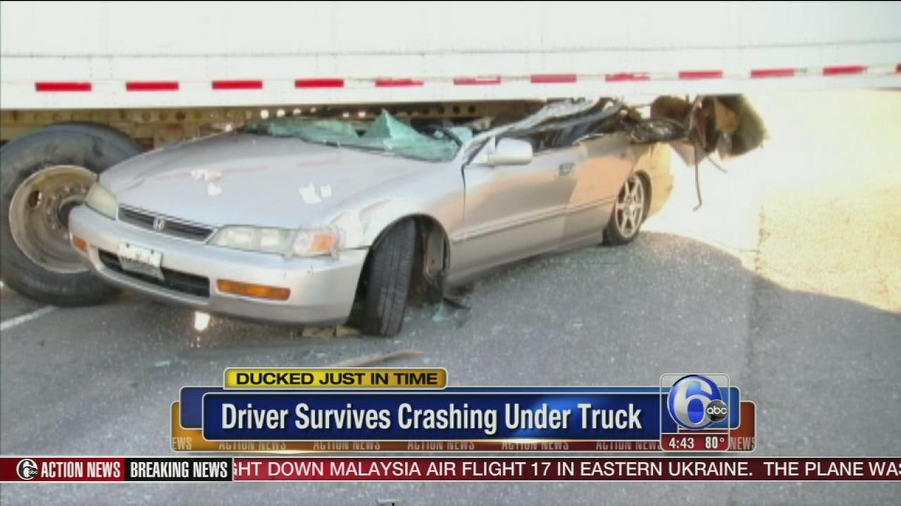VIDEO: Driver ducks, survives crash with truck