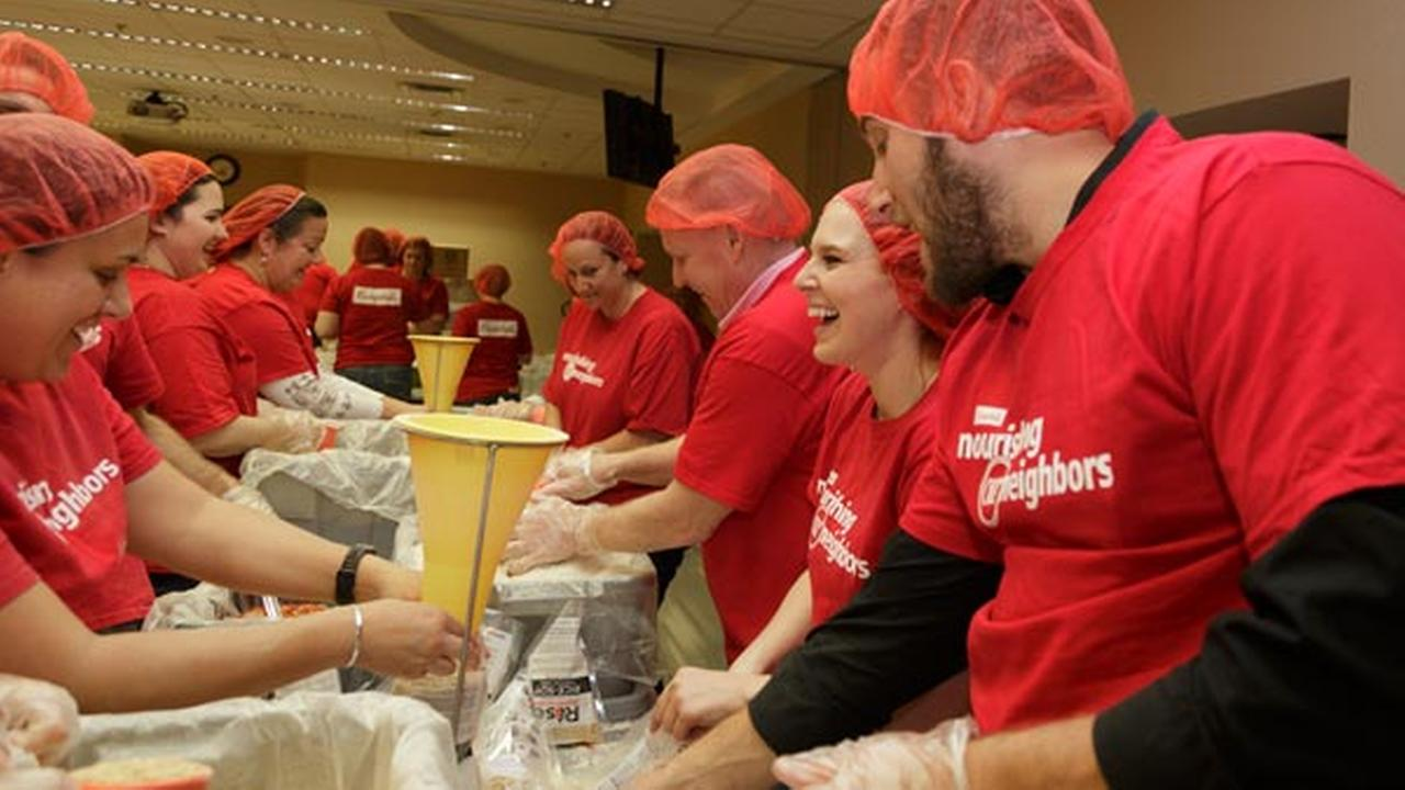 Campbell Soup Company employee volunteers sort and package thousands of meals for donation in partnership with Rise Against Hunger at Campbell headquarters in Camden.