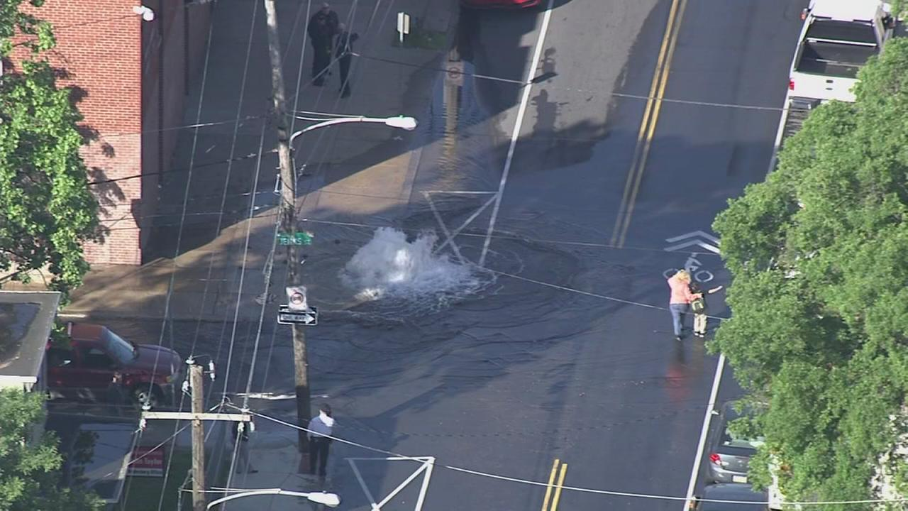 Gushing fire hydrant floods street