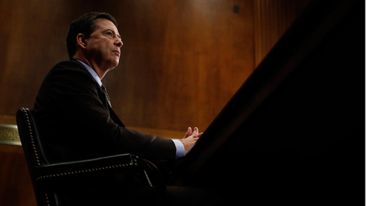 In this Wednesday, May 3, 2017, photo, then-FBI Director James Comey pauses as he testifies on Capitol Hill in Washington, before a Senate Judiciary Committee hearing.