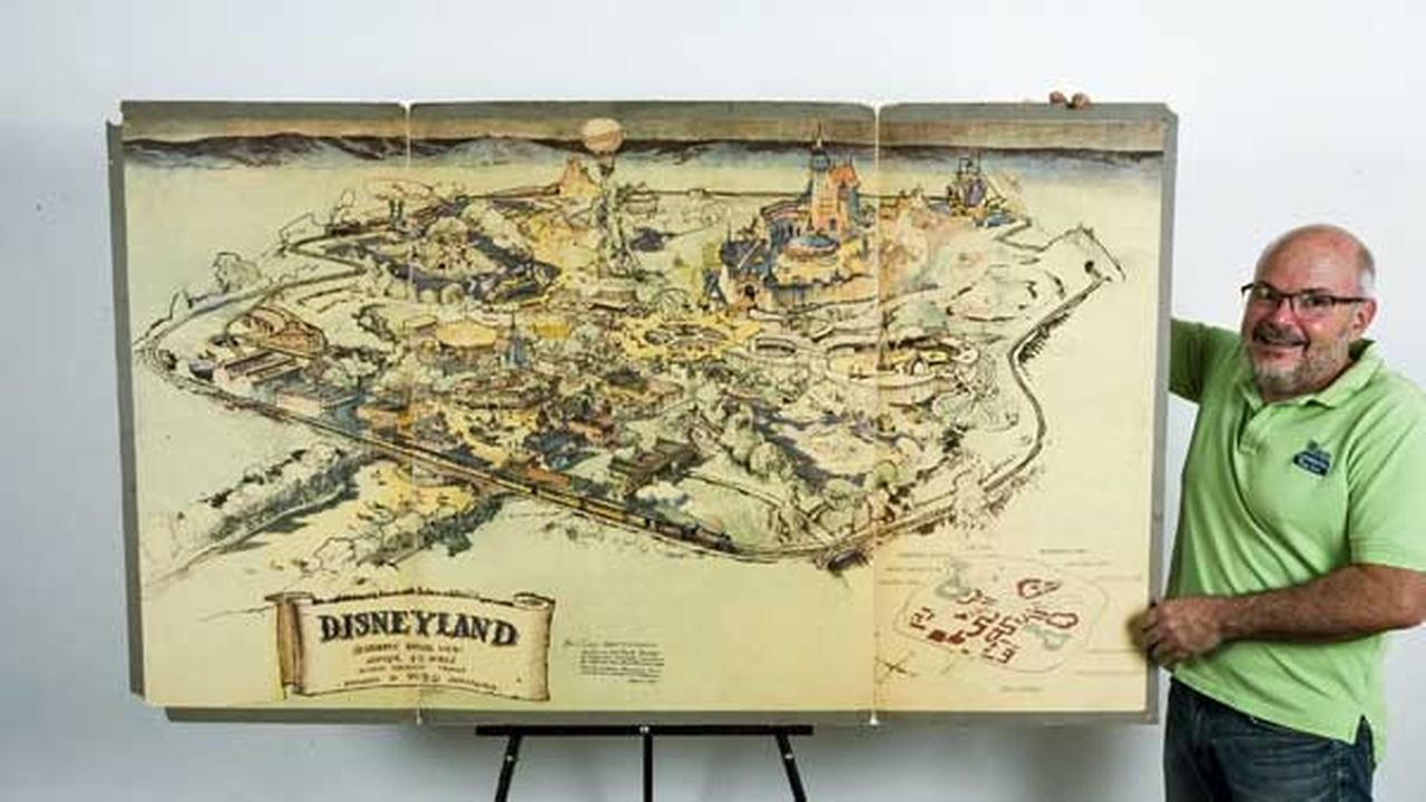 In this April 28, 2017, photo art dealer Mike Van Eaton stands next to a hand-drawn map from 1953 that shows Walt Disneys original ideas for Disneyland.