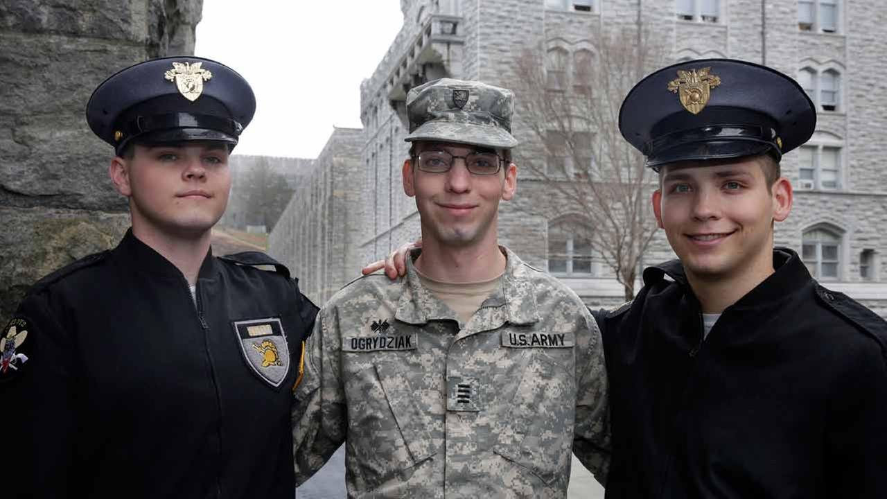 In this Friday April 21, 2017 photo, twin Cadets Cole Ogrydziak, left, and Sumner Ogrydziak, right, and older brother Cadet Noah Ogrydziak, pose at  the U.S. Military Academy.