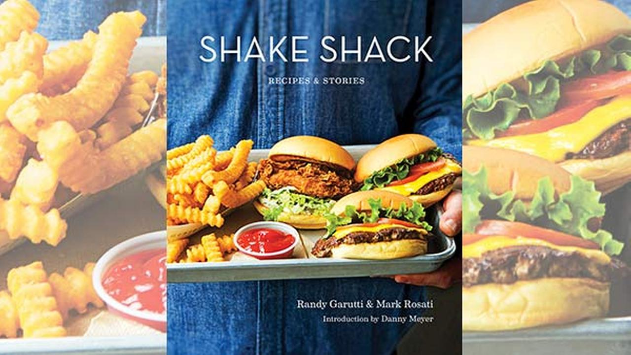 This image provided by Penguin Random House shows the cover of the book Shake Shack: Recipes and Stories.