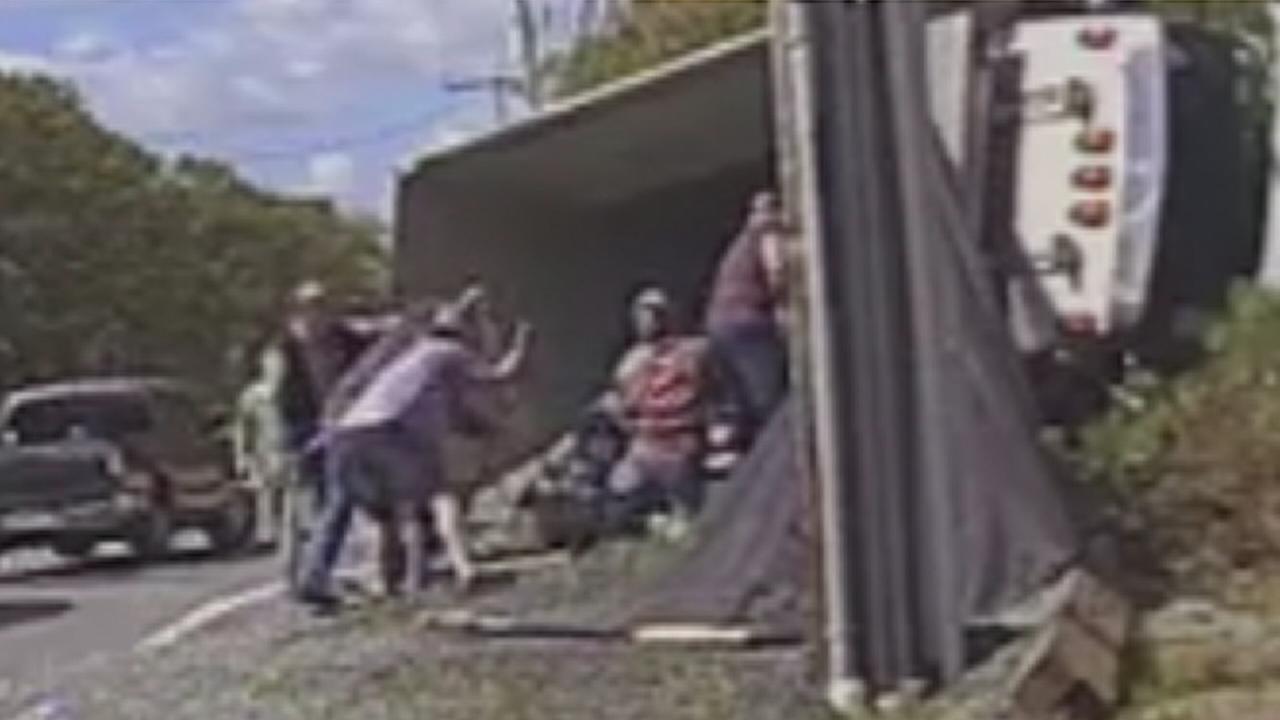 VIDEO: NJ driver rescued after dump truck overturns on car