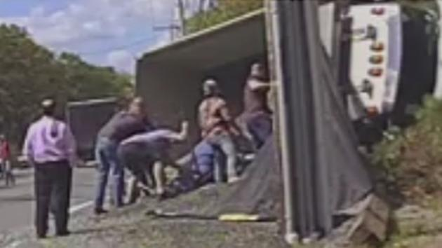 RAW VIDEO: Woman rescued after dump truck flips onto car
