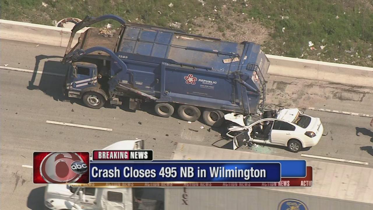 Car hits garbage truck on I-495 in Wilmington