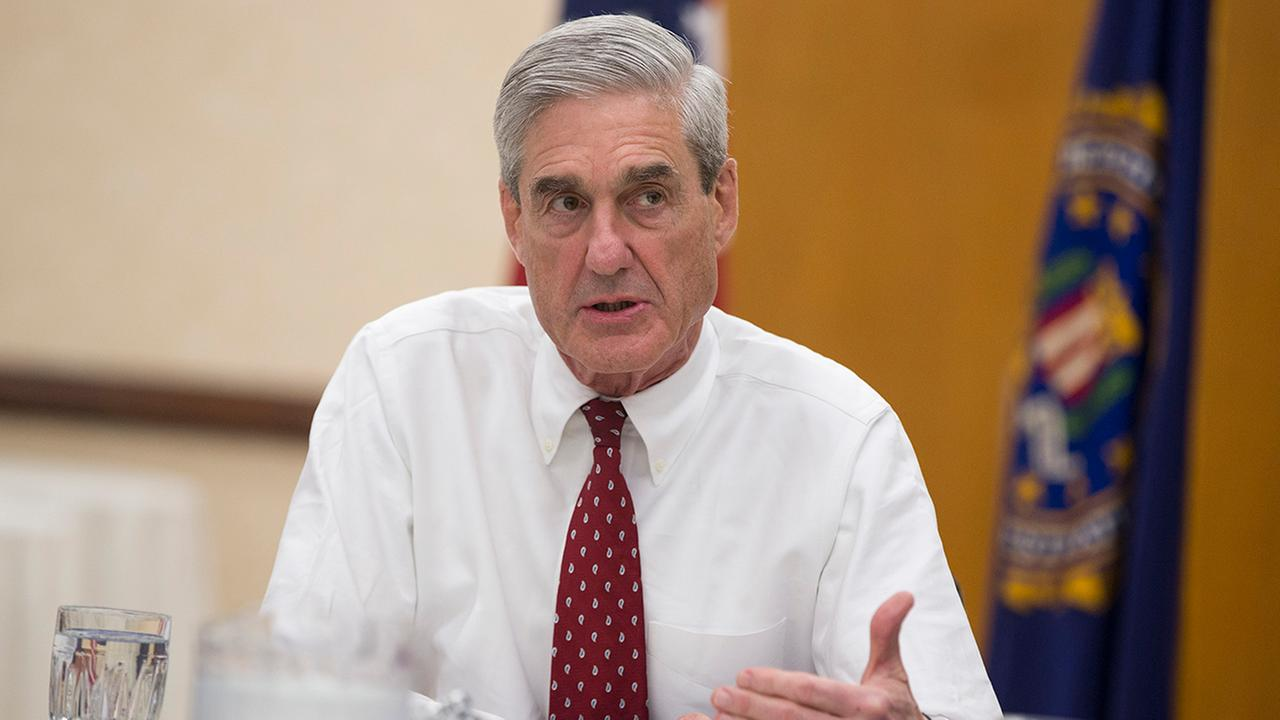Former FBI director Robert Mueller speaks during an interview at FBI headquarters on Wednesday, Aug. 21, 2013, in Washington.