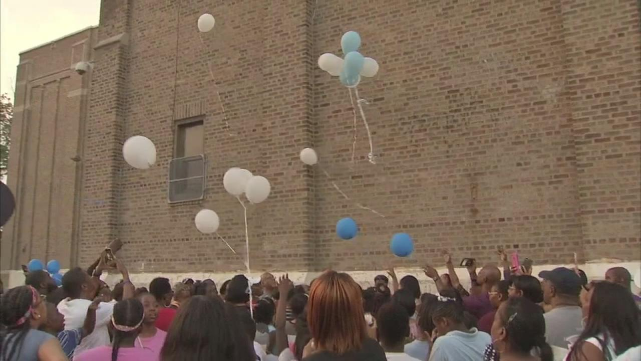 Vigil held for boy, mom wants end to bullying